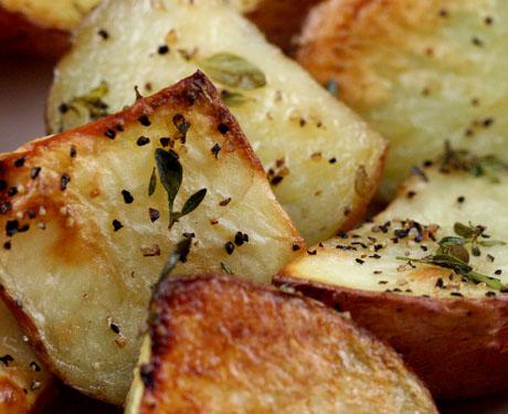 Thyme roasted potatoes, crispy on the outside, creamy inside.