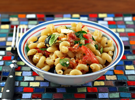 Pasta salad with feta, basil, fresh and slow-roasted tomatoes