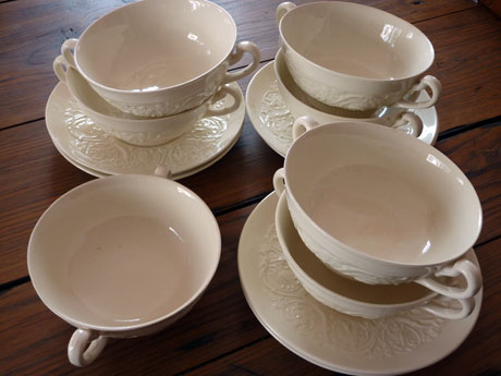 Seven white soup bowls, with six saucers