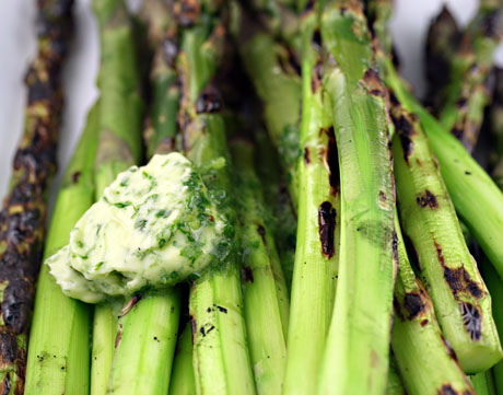 Asparagus, grilled and topped with chive and parsley butter