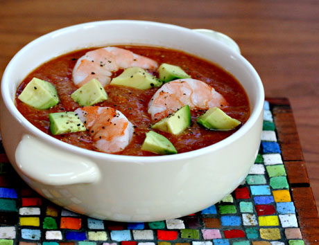 Mango gazpacho soup with shrimp and avocado.
