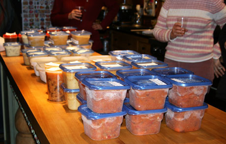 Soups lined up in the kitchen for Soup Swap