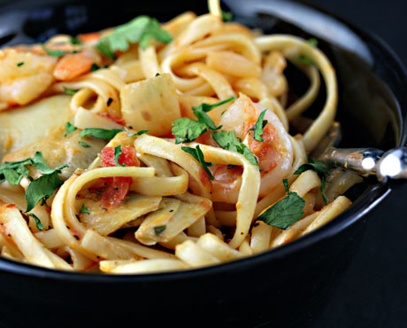 Pasta with roasted tomatoes, artichokes and shrimp