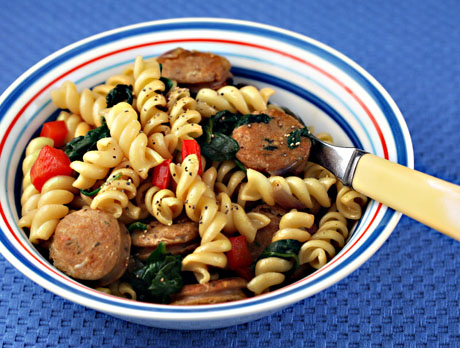 Farfalle with spinach and sausage comes together quickly with ingredients from the pantry.