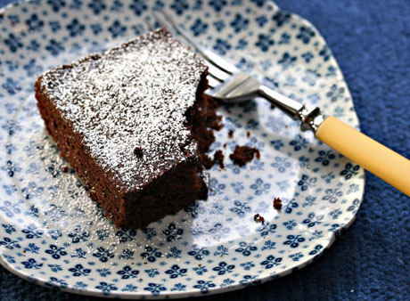 Chocolate dump cake topped with powdered sugar.