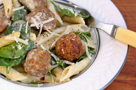Turkey-falafel-meatballs-with-spinach-pasta-and-tahini-dressing-closeup