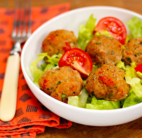 Italian turkey meatballs, served on a garden salad.
