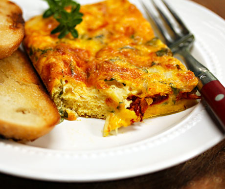 Egg casserole with Italian cheeses, sun-dried tomato and basil.