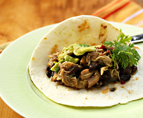 Slow cooker tomatillo chicken and black bean tacos, from The Perfect Pantry.