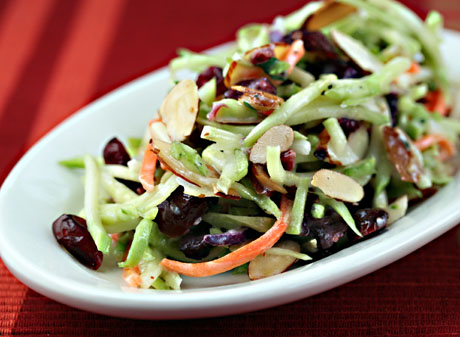 Broccoli slaw salad with cranberries, almonds, and yogurt dressing, from The Perfect Pantry.