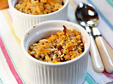 This mango and raspberry crisp has a gluten-free almond topping.