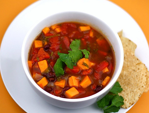 Black bean and sweet potato soup: the colors of the season, from Two Peas & Their Pod (on Soup Chick).
