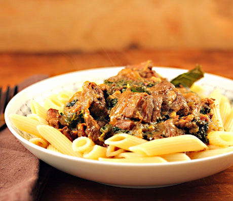 Slow cooker beer-braised beef and kale stew, delicious on its own or over pasta.