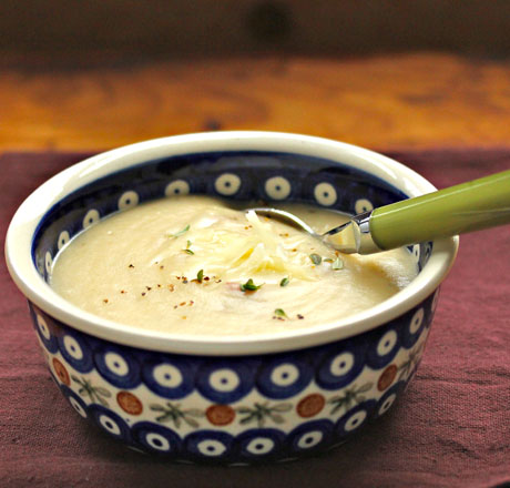 Roasted cauliflower and potato soup, topped with cheese.