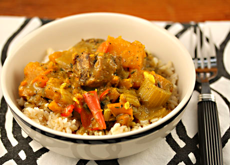 Caribbean chicken curry with chunks of butternut squash and red bell peppers, served over rice.