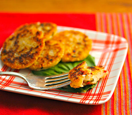 Mini roasted red pepper, basil and parmesan cheese johnnycakes, a gluten-free appetizer.