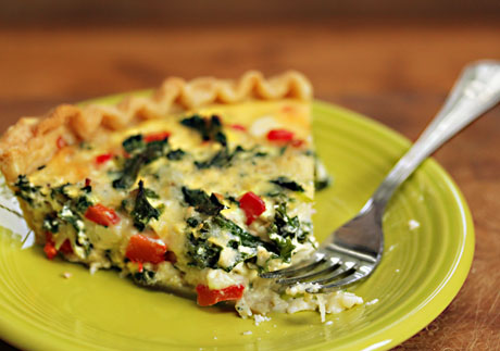 A slice of kale and feta quiche, for breakfast or a light supper.