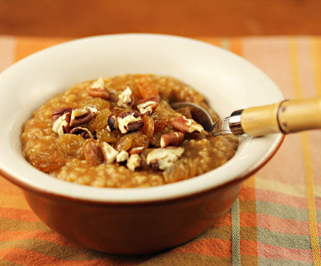 Pumpkin spice oatmeal, topped with nuts and raisins, on The Perfect Pantry.