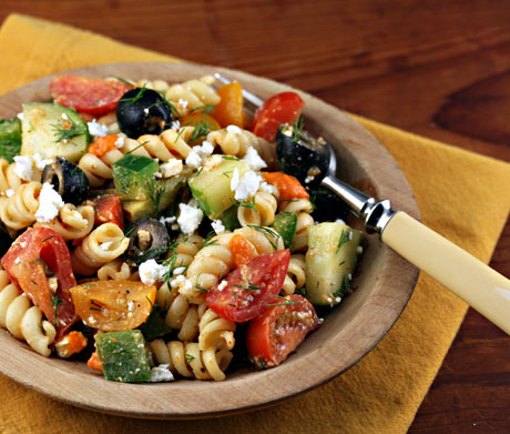 Olives, feta, and a roasted red pepper dressing make this Greek pasta salad a winner.