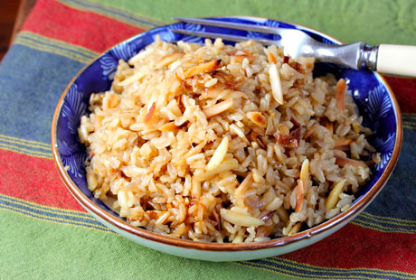 Brown rice and almond pilaf, made in the rice cooker, made brown rice our first choice of side dish.