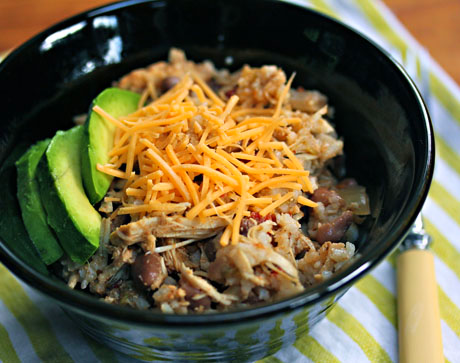 Slow cooker chicken and pinto bean burrito, in a bowl.