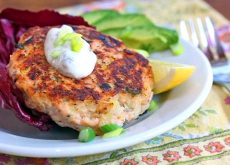 Salmon burgers with green yogurt sauce (The Perfect Pantry).