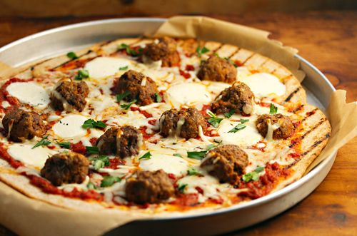 """Whole wheat meatball pizza, the most """"Rhode Island"""" recipe in the cookbook. The pizza made the cut, but this photo didn't."""