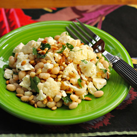 Enjoy this cauliflower salad with white beans, feta and pine nuts warm or cold.