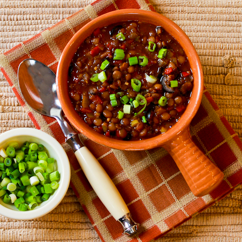 Vegan lentil chili with roasted red peppers, olives and green onion, from Kalyn's Kitchen (on Soup Chick).