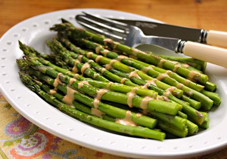 Roasted asparagus with Sriracha drizzle.