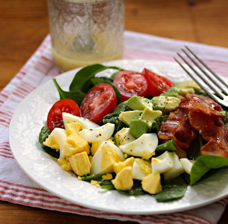 Spinach salad with honey mustard vinaigrette.