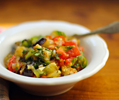 Moroccan eggplant salad with tomatoes and fresh herbs.