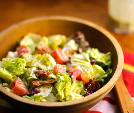 Bacon, lettuce and tomato salad with creamy basil dressing.