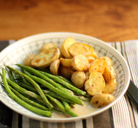 Roasted green beans and potatoes with creamy sesame dressing.