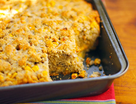Mexican red corn bread, with green chiles and corn kernels.