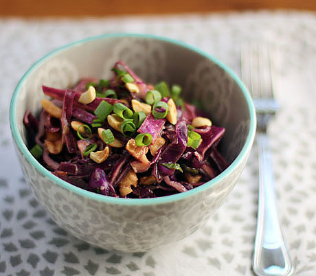 Vegan Asian red cabbage slaw with peanuts, scallions and mint.