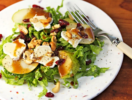 Pear and brie salad with cashews and dried cranberries.