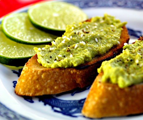Bright green, and bright flavored, vegan avocado and edamame spread on toast (The Perfect Pantry).