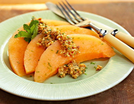 Use your favorite ripe melon for this salad with lime, peanut and mint topping.