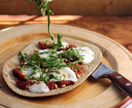 Slow-roasted tomato flatbread pizza, with mozzarella cheese, pine nuts and basil. #pizza