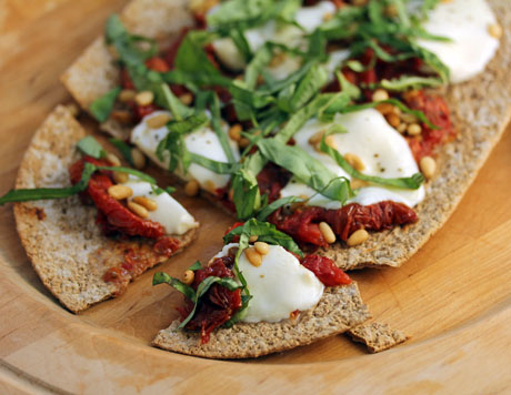Slow-roasted tomatoes, fresh mozzarella cheese, pine nuts and basil: a quick and easy flatbread pizza. #vegetarian