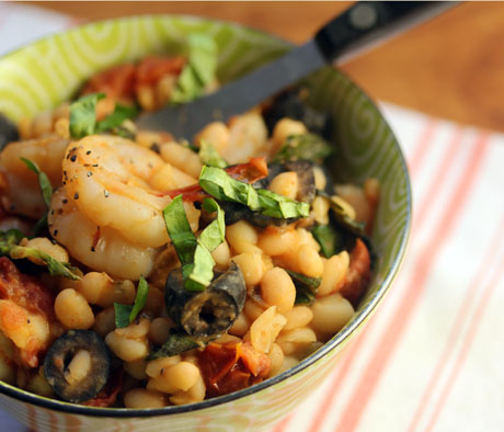 White beans with shrimp, basil, and slow-roasted tomatoes. #glutenfree