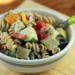Whole wheat pasta turkey salad with vegetables and feta-herb-yogurt dressing