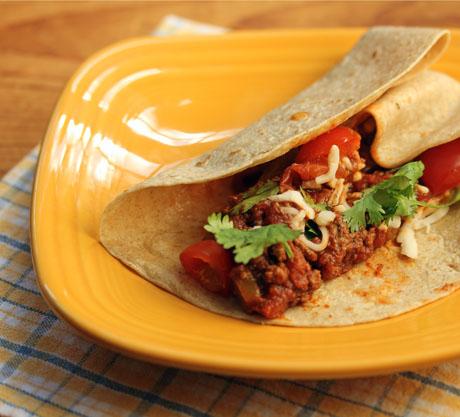 Tex-Mex taco sauce fills a tortilla.