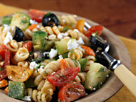 Greek pasta salad with tomatoes, cucumber, feta and olives. #salad #vegetarian