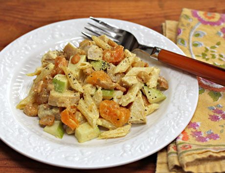 Curried chicken pasta salad, chock full of dried apricots and raisins. #salad #pasta #chicken