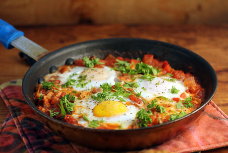 Shakshuka, a Tunisian-Israeli dish of eggs poached in a fiery tomato sauce.