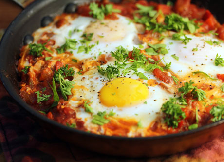 Enjoy shakshuka (eggs poached in tomato sauce) for breakfast or dinner. #vegetarian