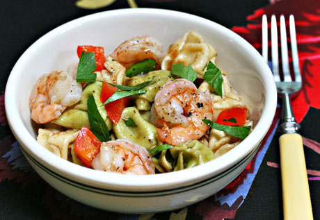 Tortellini and shrimp salad recipe, with tomatoes or peppers and garden-fresh herbs, will be welcome at any summer picnic or potluck. #salad #shrimp #pasta