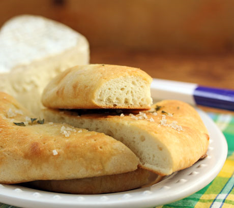 Salty pizza bianca makes the perfect match for gooey cheese.